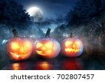 scary pumpkin in a dark smoky... | Shutterstock . vector #702807457