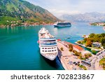 sea cruise liners near the pier ... | Shutterstock . vector #702823867