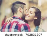 happy woman hugging her male...   Shutterstock . vector #702831307