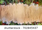 christmas wooden background | Shutterstock . vector #702845437