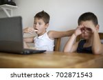 young boys sitting in front of... | Shutterstock . vector #702871543