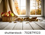 wooden old table in an autumnal ... | Shutterstock . vector #702879523