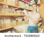 smiling girl with disposable... | Shutterstock . vector #702880063