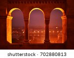 large arched window in buda... | Shutterstock . vector #702880813