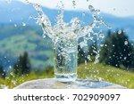 a glass of fresh water  | Shutterstock . vector #702909097