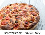 focaccia typical of bari italy... | Shutterstock . vector #702931597
