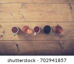 overhead shot of five cups of... | Shutterstock . vector #702941857