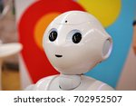 Small photo of Milan, Italy - May 22, 2017: The head of a Softbank Pepper robot. The robot is making multi-lingual announcement.
