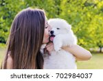 happy woman playing in the park ...   Shutterstock . vector #702984037