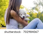 happy woman playing in the park ... | Shutterstock . vector #702984067