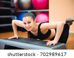 athletic woman trainer doing... | Shutterstock . vector #702989617