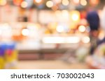 abstract blurred background.... | Shutterstock . vector #703002043