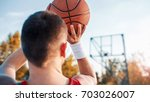 basketball. young basketball... | Shutterstock . vector #703026007