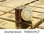 bitcoin laying on stacked gold... | Shutterstock . vector #703031917