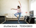 beautiful woman dancing in the... | Shutterstock . vector #703043803