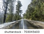snow on roads and forest on... | Shutterstock . vector #703045603