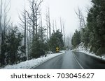 snow on roads and forest on... | Shutterstock . vector #703045627