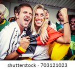 german couple supporting the... | Shutterstock . vector #703121023