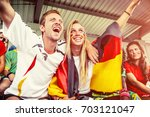 german couple supporting the... | Shutterstock . vector #703121047