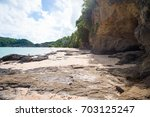 rocky coastline on ao yon beach ... | Shutterstock . vector #703125247
