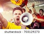german fan shouting with... | Shutterstock . vector #703129273