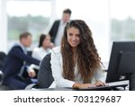 manager woman sitting behind a... | Shutterstock . vector #703129687