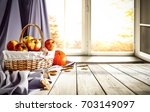 old wooden table by the window... | Shutterstock . vector #703149097