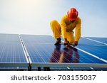 technician checks the... | Shutterstock . vector #703155037
