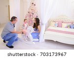 beautiful young mom and dad... | Shutterstock . vector #703173967