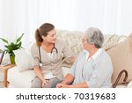 nurse talking with her patient... | Shutterstock . vector #70319683