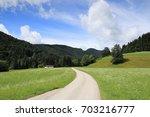 small street in the bavarian... | Shutterstock . vector #703216777