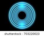 abstract blue rings light neon... | Shutterstock .eps vector #703220023