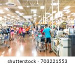 blurred image a busy cashier... | Shutterstock . vector #703221553