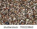 multi colored sea pebbles on... | Shutterstock . vector #703223863