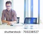 creative businessman reading...   Shutterstock . vector #703238527