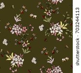 seamless floral pattern in... | Shutterstock .eps vector #703244113