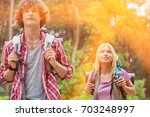 young hiking couple looking... | Shutterstock . vector #703248997