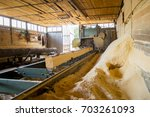 Small photo of Sawmill. Process of machining logs in equipment sawmill machine saw saws the tree trunk on the plank boards. Wood sawdust work sawing timber wood wooden woodworking
