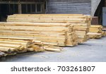 sawmill. warehouse for sawing... | Shutterstock . vector #703261807