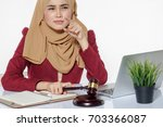 serious face expression lawyer... | Shutterstock . vector #703366087