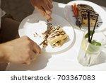 man eating dessert. | Shutterstock . vector #703367083
