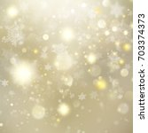 new year and xmas gold dust.... | Shutterstock .eps vector #703374373