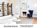 modern white interior design in ... | Shutterstock . vector #703393057