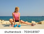 young athletic woman exercising ... | Shutterstock . vector #703418587
