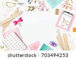 frame with stylish stationery....   Shutterstock . vector #703494253