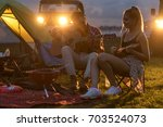 camping tent with blured image... | Shutterstock . vector #703524073