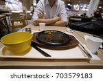 an empty plate  dirty after the ...   Shutterstock . vector #703579183