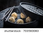 closeup of manti dumplings in... | Shutterstock . vector #703583083