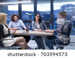 group of a young business... | Shutterstock . vector #703594573