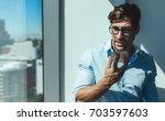 businessman sending voice...   Shutterstock . vector #703597603